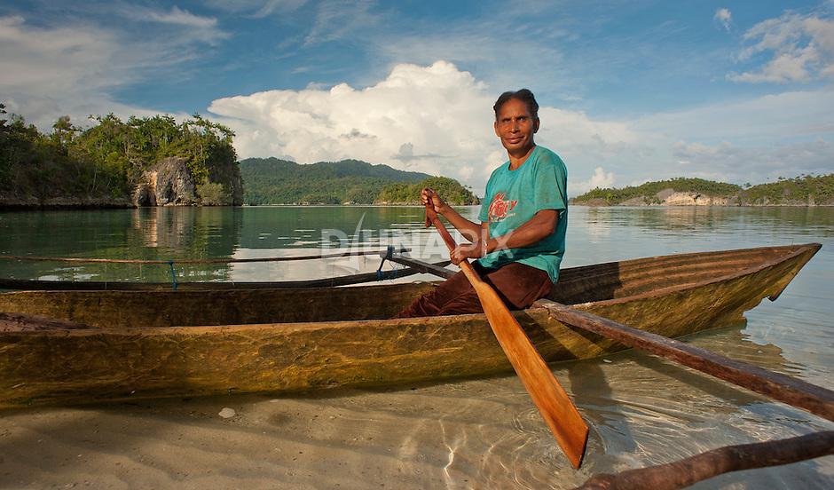A fisher woman makes camp at Temintoi, Triton Bay, Papua.