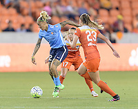 Houston, TX - Friday April 29, 2016: Tasha Kai (32) of Sky Blue FC races up the field with the ball as Cami Privett (23) and Andressa (17) of the Houston Dash chase her at BBVA Compass Stadium. The Houston Dash tied Sky Blue FC 0-0.