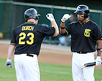 SIOUX FALLS, SD - MAY 20:  Chase Burch #23 from the Sioux Falls Canaries gets a high five from teammate Stephen Branca after a solo home run against the Gary Southshore Railcats in the sixth inning Tuesday evening at the Canaries Stadium.  (Photo by Dave Eggen/Inertia)