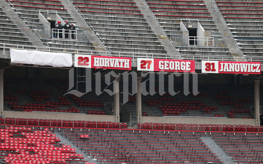 A tarp covers the spot where former Ohio State University quarterback Troy Smith's name will be revealed as he is honored at next week's game seen before the college football game between the Ohio State Buckeyes and the Indiana Hoosiers at Ohio Stadium in Columbus, Saturday morning, November 22, 2014. (The Columbus Dispatch / Eamon Queeney)