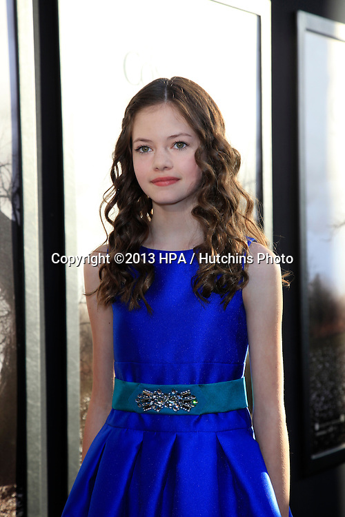 "LOS ANGELES - JUL 15:  Mackenzie Foy arrives at the ""The Conjuring"" Premiere at the Cinerama Dome on July 15, 2013 in Los Angeles, CA"