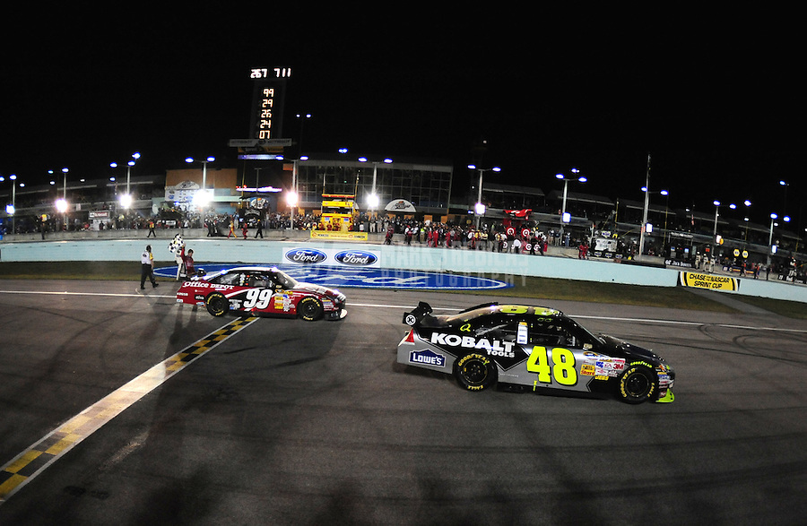 Nov. 16, 2008; Homestead, FL, USA; NASCAR Sprint Cup Series driver Jimmie Johnson (48) celebrates his 2008 championship while Carl Edwards (99) celebrates his victory in the Ford 400 at Homestead Miami Speedway. Mandatory Credit: Mark J. Rebilas-