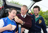 The proof of the sandwich is in the 'eating' says Micheal O'Muircheartaigh who made the perfect 'match day hang sandwich' for the Munster final in Killarney pictured with his son Micheal and grandson Aengus who relishes the taste! Brown bread, home cured ham, a little lettuce and tomatoe and evenly trimmed around the edges.<br /> Picture by Don MacMonagle
