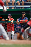 Lowell Spinners hitting coach Nate Spears (left) and Trey Ganns (right) watch from the dugout during a game against the Batavia Muckdogs on July 15, 2018 at Dwyer Stadium in Batavia, New York.  Lowell defeated Batavia 6-2.  (Mike Janes/Four Seam Images)