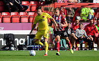 Fleetwood Town's Danny Andrew under pressure from Lincoln City's Harry Anderson<br /> <br /> Photographer Chris Vaughan/CameraSport<br /> <br /> The EFL Sky Bet League One - Lincoln City v Fleetwood Town - Saturday 31st August 2019 - Sincil Bank - Lincoln<br /> <br /> World Copyright © 2019 CameraSport. All rights reserved. 43 Linden Ave. Countesthorpe. Leicester. England. LE8 5PG - Tel: +44 (0) 116 277 4147 - admin@camerasport.com - www.camerasport.com