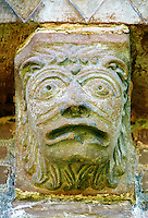 Norman Romanesque exterior corbel no 38 - sculpture of a head, half man half lion with a mouth like a theatrical mask. The Norman Romanesque Church of St Mary and St David, Kilpeck Herefordshire, England. Built around 1140