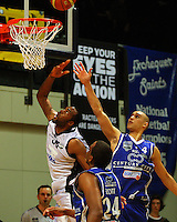 Michael Harrison lays up under pressure from Saints guard Lindsay Tait during the NBL Semifinal basketball match between the Wellington Saints and Nelson Giants at TSB Bank Arena, Wellington, New Zealand on Thursday, 12 June 2008. Photo: Dave Lintott / lintottphoto.co.nz