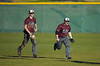 (L-R) Concord Mountain Lions outfielders Ryan Fralin (28) and Richard Ortiz (16) celebrate their win over the Wingate Bulldogs at Ron Christopher Stadium on February 2, 2020 in Wingate, North Carolina. The Mountain Lions defeated the Bulldogs 12-11. (Brian Westerholt/Four Seam Images)