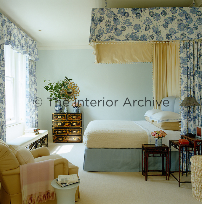 This side view of the master bedroom shows a half-tester bed and curtains of chrysanthemum print