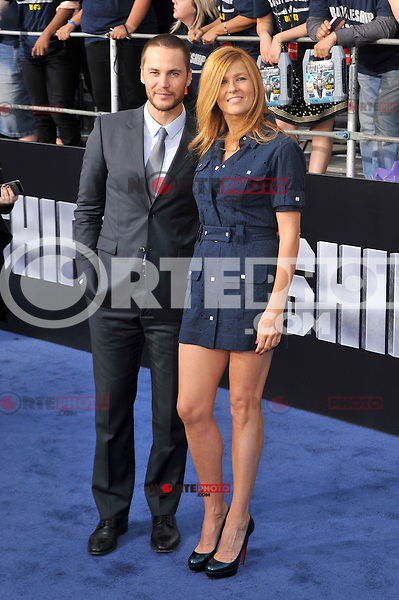 Taylor Kitsch and Connie Britton at the film premiere of 'Battleship,' at the NOKIA Theatre at L.A. LIVE in Los Angeles, California. May, 10, 2012. ©mpi35/MediaPunch Inc.