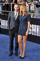 Taylor Kitsch and Connie Britton at the film premiere of 'Battleship,' at the NOKIA Theatre at L.A. LIVE in Los Angeles, California. May, 10, 2012. © mpi35/MediaPunch Inc.