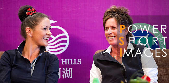 HAIKOU, CHINA - OCTOBER 28: Oscar-winning actress Catherine Zeta-Jones (L) and Solheim Cup's captain Rosie Jones of the USA attend a press conference during the Mission Hills Star Trophy on October 28, 2010 in Haikou, China. The Mission Hills Star Trophy is Asia's leading leisure liflestyle event and features Hollywood celebrities and international golf stars. Photo by Victor Fraile / The Power of Sport Images