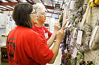 NWA Democrat-Gazette/DAVID GOTTSCHALK  Judges Diane Miller (left) and Virginia Cantrel examine wreathes Monday, August 31, 2015 inside the Thompson Hall Adult Home Economics building on the Washington County Fair Grounds in Fayetteville. The wreaths are entered in the Youth Home Furnishings division at the fair that begins today and runs through Saturday.