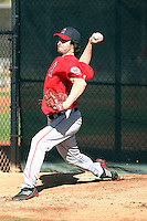 Dan Haren #24 of the Los Angeles Angels throws a bullpen session during spring training workouts at the Angels complex on February 16, 2011  in Tempe, Arizona. .Photo by:  Bill Mitchell/Four Seam Images.