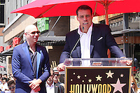 HOLLYWOOD, CA - JULY 15: Pitbull, pictured with Tony Robbins, receives star at the Hollywood Walk of Fame in Hollywood, California on July 15, 2016. Credit: David Edwards/MediaPunch