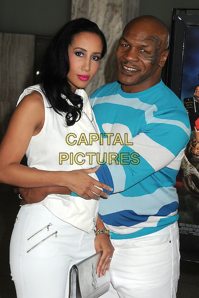 "Lakiha Spicer & Mike Tyson.Attending the ""Scary Movie 5"" Los Angeles film premiere held at the Cinerama Dome,  Hollywood, California, USA, .11th April 2013..half length trousers arms around husband wife couple tattoo on face blue white print jumper sweater clutch bag silver top jeans  .CAP/ADM/BP.©Byron Purvis/AdMedia/Capital Pictures"