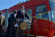 May 1, 2013  (Washington, DC)  D.C. Mayor Vincent Gray speaks about the District's new streetcars during a news conference at the DDOT Anacostia facility May 1, 2013, as DDOT Director Terry Bellamy (left) and other officials listen.   (Photo by Don Baxter/Media Images International)