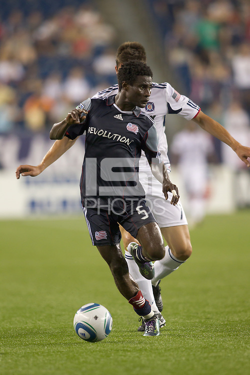 New England Revolution defender Emmanuel Osei (5) controls the ball as Chicago Fire forward Stefan Dimitrov (7) pressures. The Chicago Fire defeated the New England Revolution, 1-0, at Gillette Stadium on June 27, 2010.