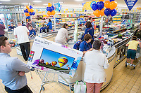 Thursday  28 July 2014<br /> Pictured: Customes line up to pay in the store.  Re: ALDI Merthyr Tydfill Grand Re-opening
