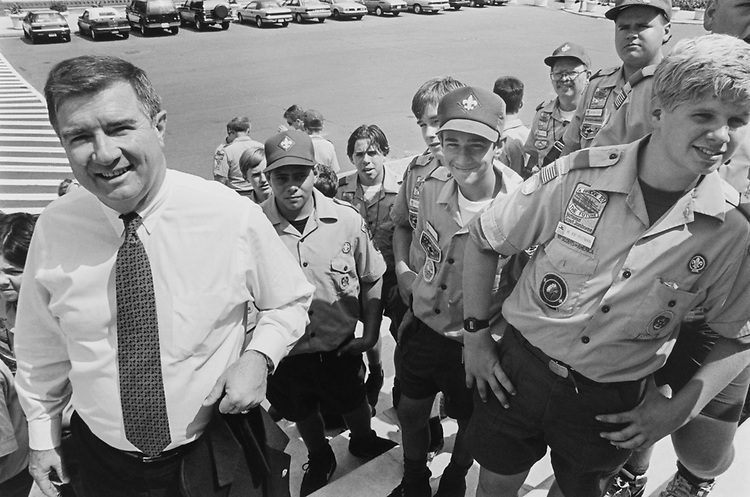 Rep. Greg Laughlin, D-Tex. up on the steps of Capitol Hill with some of his constituents, including a group of boy scouts from Victoria on their way to National Scout Jamboree. July 27, 1993. (Photo by Maureen Keating/CQ Roll Call)