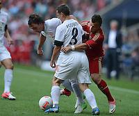 FUSSBALL   1. BUNDESLIGA  SAISON 2012/2013   3. Spieltag FC Bayern Muenchen - FSV Mainz 05     15.09.2012 Julian Baumgartlinger (li, 1. FSV Mainz 05) und Zdenek Pospech (Mitte, 1. FSV Mainz 05) gegen Xherdan Shaqiri (FC Bayern Muenchen)