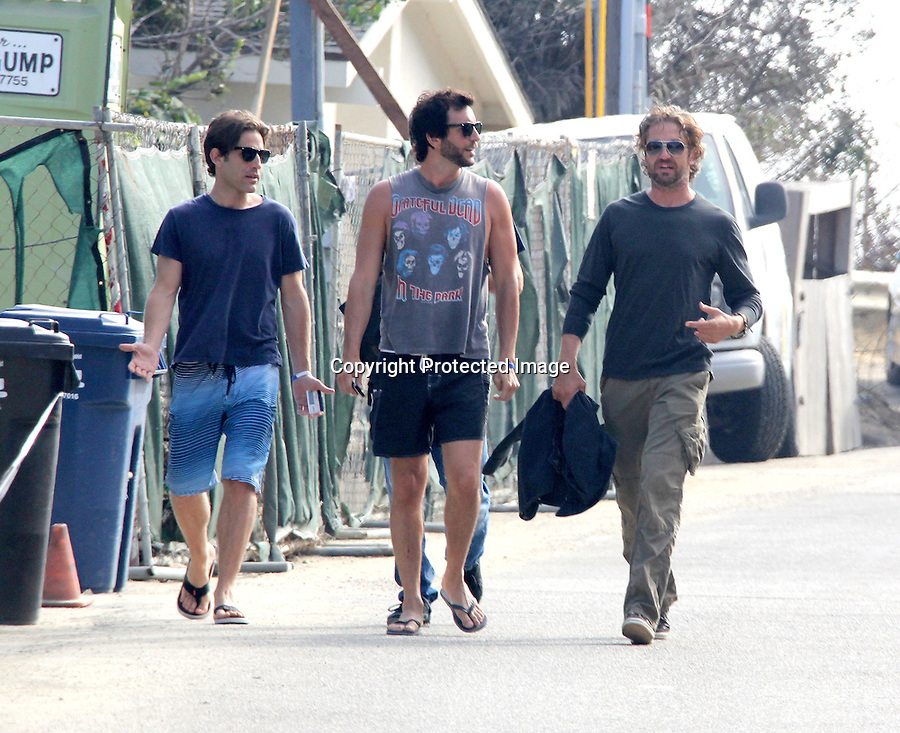 July 3rd 2011  ...Gerard Butler walking with a bunch of dudes to a pre 4th of July party at a beach house in Malibu California. Gerald was holding is red white & blue wrist band to get inside the party. Paris Hilton & Bradley Cooper were also at the party .....AbilityFilms@yahoo.com.805-427-3519.www.AbilityFilms.com