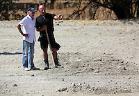 Pictured: Eddie Needham (L), the grandfather of missing Ben Needham, is shown around the soil examination process by an officer in Kos, Greece. Wednesday 05 October 2016<br />