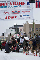Ray Redington Jr and team leave the ceremonial start line with an Iditarider and handler at 4th Avenue and D street in downtown Anchorage, Alaska on Saturday March 3rd during the 2018 Iditarod race. Photo ©2018 by Brendan Smith/SchultzPhoto.com