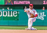 30 August 2015: Washington Nationals second baseman Danny Espinosa makes a throw from his knees to get Miami Marlins infielder Miguel Rojas out in the 7th inning at Nationals Park in Washington, DC. The Nationals rallied to defeat the Marlins 7-4 in the third game of their 3-game weekend series. Mandatory Credit: Ed Wolfstein Photo *** RAW (NEF) Image File Available ***