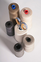Photo of a group of Industrial Thread Bobbins used in the Fashion & Apparel Industry.