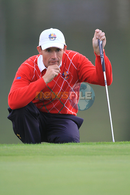 2010 Ryder Cup at the Celtic Manor twenty ten course, Newport Wales, 1/10/2010 on day one of play After play restarted at 5 pm..Padraig Harrington lines up his putt on the 6th green..Picture Fran Caffrey/www.golffile.ie.