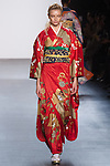 "Model walks runway in a ""Positive"" silk kimono from the Hiromi Asai Fall Winter 2016 ""Spirit of the Earth"" collection by Hiromi Asai & Kimono Artisan Kyoto, presented at NYFW: The Shows Fall 2016, during New York Fashion Week Fall 2016."