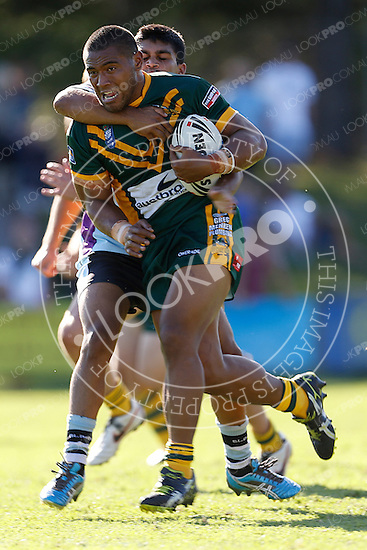 Ronnie Alovili of the Wyong Roos is tackled by Tyrone Peachey of the Cronulla Sharks during Round 5 of the 2013 NSW Cup at Morrie Breen Oval on April 7, 2013 in Wyong, Australia. (Photo by Paul Barkley/LookPro)