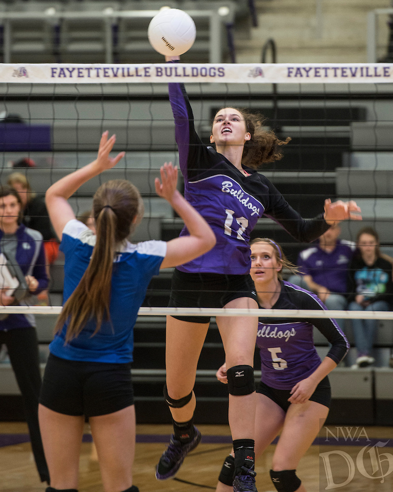 STAFF PHOTO ANTHONY REYES &bull; @NWATONYR<br /> Faith Waitsman (12) of Fayetteville, spikes the ball against Bryant Tuesday, Oct. 28, 2014 during the 7A state volleyball tournament Bulldog Gymnasium. The Bulldogs won 3-1.