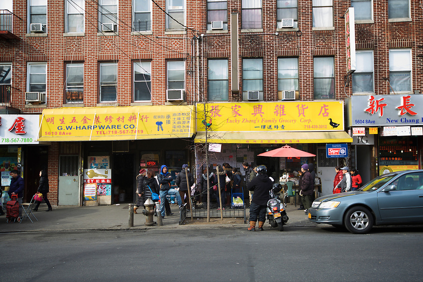 BROOKLYN, NY - JANUARY 15, 2016:  Daily life on 8th Avenue in Sunset Park. Over the last few decades, this strip has become one of New York's busiest Chinatowns. <br /> LOCATION: 8th Avenue between 56th and 57th Streets.<br /> CREDIT: Clay Williams for the New York Times.<br /> <br /> &copy; Clay Williams / claywilliamsphoto.com