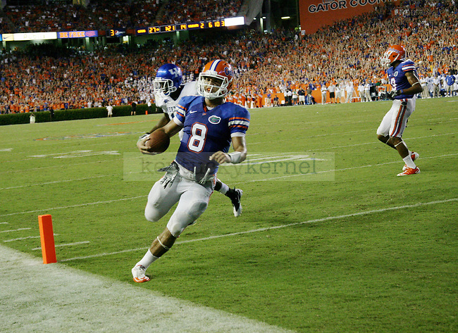 """Florida quarterback Trey Burton rushes into the end zone for a touchdown during the second half of UK's game against Florida at the """"Swamp"""" in Gainesville, Florida on Saturday, Sept. 25, 2010. Photo by Brandon Goodwin 