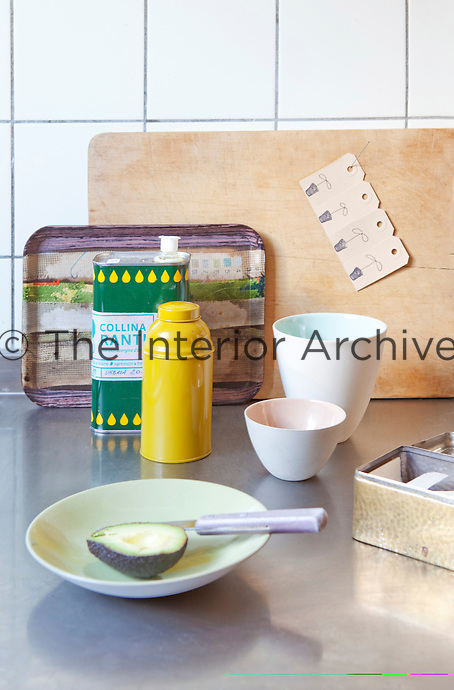 Crockery and other kitchen items sit out on the stainless steel work surface