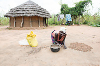 N. Uganda, Kitgum District. Woman sorting sorghum.