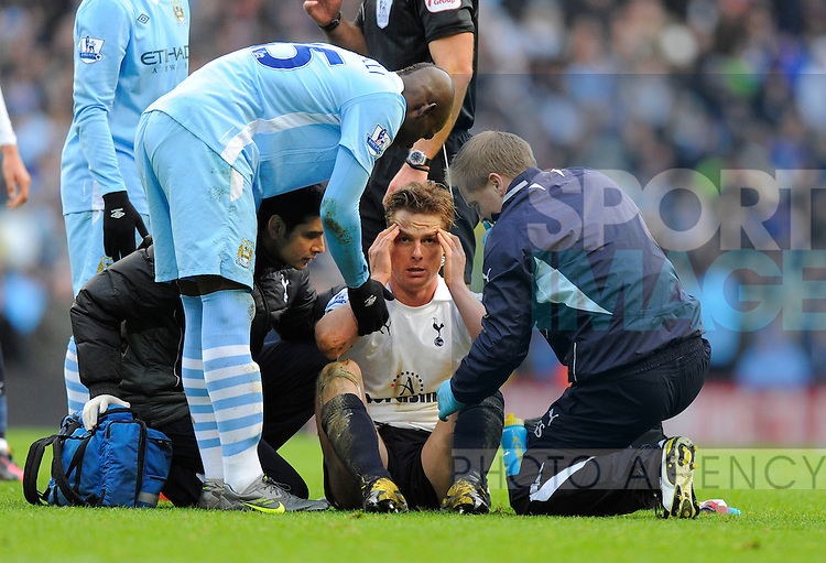 Mario Balotelli of Manchester City looks on as Scott Parker of Tottenham receives treatment after he stamped him in the face.Barclays Premier League.Manchester City v Tottenham at the Eithad Stadium, Manchester 22nd January, 2012..Sportimage +44 7980659747.picturedesk@sportimage.co.uk.http://www.sportimage.co.uk/.Editorial use only. Maximum 45 images during a match. No video emulation or promotion as 'live'. No use in games, competitions, merchandise, betting or single club/player services. No use with unofficial audio, video, data, fixtures or club/league logos.