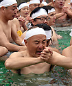 January 8, 2017, Tokyo, Japan - Participants pray absorbedly during a new years annual cold water dousing ritual in downtown Tokyo on a cold Sunday of January 8, 2017. Practitioners of Shinto, a Japanese ethnic religion focusing on ritual practices to be carried out diligently, immerse themselves in icy water under the frigid temperatures in the purification ritual, believed to cleanse the spirit or just to show off their bravery and endurance. (Photo by Natsuki Sakai/AFLO) AYF -mis-