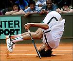 MICHAEL KOOREN..Parijs, 28-05 2003.  Roland garros, De marokkaan Younes El ayanoui maak uit frustratie een koprol op de baan.