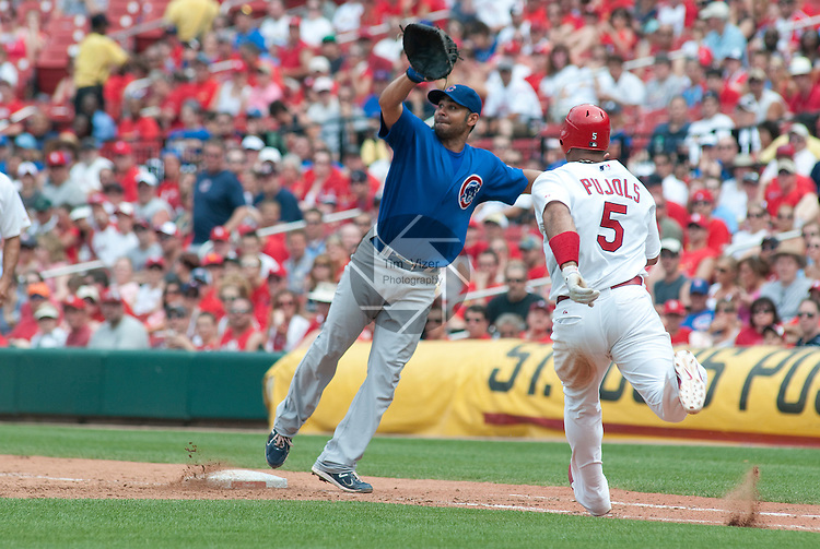 05 June 2011                 St. Louis Cardinals first baseman Albert Pujols (5) reached first on an infield single to the Cubs shortstop when Chicago Cubs first baseman Carlos Pena (22) stepped off the first base bag to make the catch in the sixth inning. The St. Louis Cardinals defeated the Chicago Cubs 3-2 in ten innings on Sunday June 5, 2011 in the final game of a three-game series at Busch Stadium in downtown St. Louis.