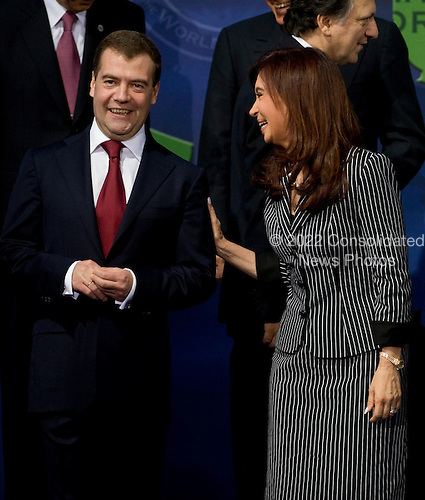 Washington, DC - November 15, 2008 -- President of Argentina Cristina Fernandez de Kirchner (R) talks with the President of Russia Dmitry Medvedev after missing the group photo at the start of the Summit on Financial Markets and the World Economy at the National Building Museum in Washington, D.C., USA, 15 November 2008. The photo was retaken after Fernandez de Kirchner joined the group..Credit: Matthew Cavanaugh - Pool via CNP