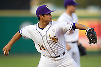 LSU Tigers third baseman Christian Ibarra #14 makes a throw to first base against the Auburn Tigers in the NCAA baseball game on March 22nd, 2013 at Alex Box Stadium in Baton Rouge, Louisiana. LSU defeated Auburn 9-4. (Andrew Woolley/Four Seam Images).
