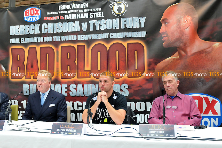 Boxer Billy Joe Saunders (C) speaks ahead of his proposed fight with Chris Eubank Junior on 29th November 2014, alongside promoter Frank Warren (L) and trainer Jimmy Tibbs - Press Conference at Fredericks, Islington, London- 25/09/14 - MANDATORY CREDIT: Philip Sharkey/TGSPHOTO - Self billing applies where appropriate - contact@tgsphoto.co.uk - NO UNPAID USE