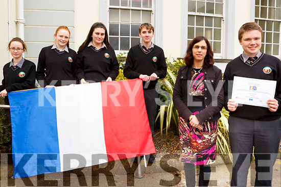 Ciaran O'Donnchu, standing front right, from Blennerville, a student in the Gaelcholáiste Chiarraí who won a national translating competition and the money won will bring several students to France on a trip. Front, Honor Nic Gloinn (Teacher) and Ciaran O'Donnchu. Holding the French flag l to r, Danica Ni Cheilleachar, Clodagh Ni Chonchuir, Brid Sionoid, Sean O'Loinsigh.