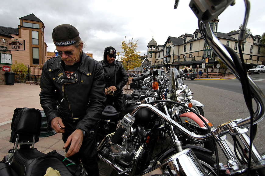 P.J. Peterson, left, and Dennis Murphy, both of Colorado Springs, get ready to ride home after attending a cancer benefit at a local bar in Manitou Springs, CO. Michael Brands for The New York Times.