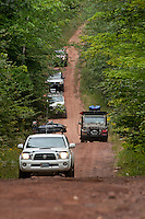 A convoy of vehicles progresses towards High Rock Bay on the Keweenaw Peninsula during the 2010 U.P. Overland trip in the Upper Peninsula of Michigan.