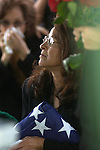 3/30/05--Juanita Ramos, wife of Arthur Ramos, clutches an American flag that was presented to her by an Army Honor Guard unit. Ramos had previously been in the army. Ramos was a victim of the British Petroleum explosion in Texas City one week ago.  Interment was at the South Park Cemetery in Pearland, TX.  Photos by Steve Campbell.     HOUCHRON CAPTION (03/31/2005) SECMETRO COLORFRONT:  WITH LOVE:  Juanita Ramos clutches an American flag that was presented to her at the funeral of her husband, Army veteran Art Ramos, Wednesday in Pearland.  Ramos was killed in the BP refinery explosion.
