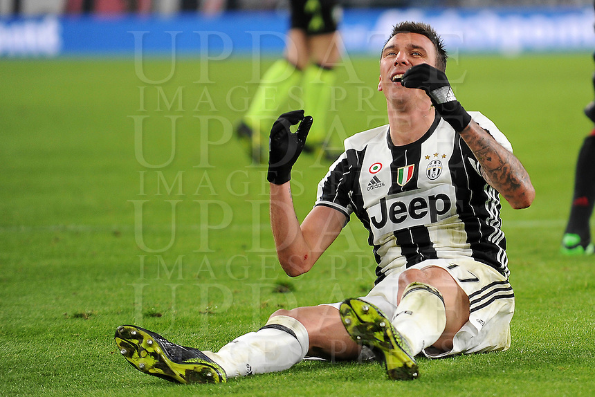 Calcio, quarti di finale di Tim Cup: Juventus vs Milan. Torino, Juventus Stadium, 25 gennaio 2017.<br /> Juventus' Mario Mandzukic reacts during the Italian Cup quarter finals football match between Juventus and AC Milan at Turin's Juventus stadium, 25 January 2017.<br /> UPDATE IMAGES PRESS/Manuela Viganti